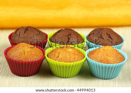 delicious cupcakes in colorful molds - black and white cakes - stock photo