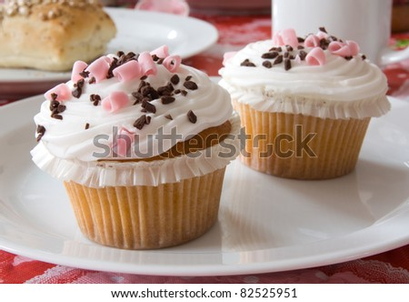 Delicious cupcakes on a plate - stock photo