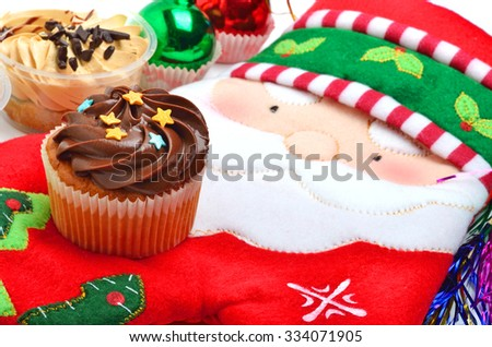 Delicious cupcakes on christmas decoration background