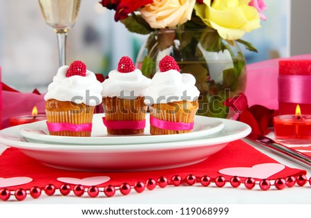 Delicious cupcakes with cream air on festive table close-up