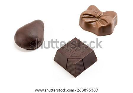 Delicious dark and milk chocolate pralines - stock photo