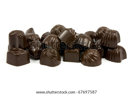 Delicious dark chocolate pralines  isolated on white - stock photo