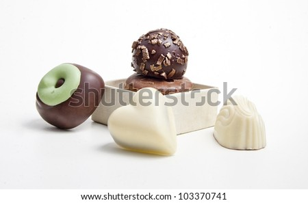 Delicious dark, milk, and white chocolate pralines. - stock photo