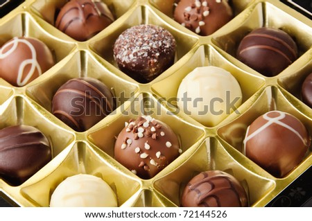 Delicious dark white and milk chocolate pralines - stock photo