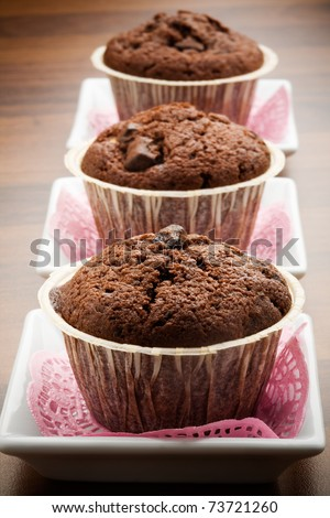 Delicious decorated chocolate muffins with selective focus