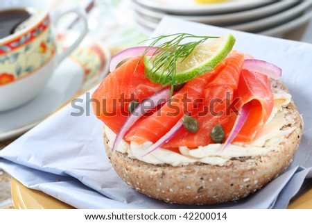 delicious deli lunch, wholegrain bagel with smoked salmon, narrow focus - stock photo