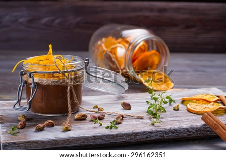 Delicious dessert chocolate mousse in glass jar. Beautiful design of dessert. - stock photo