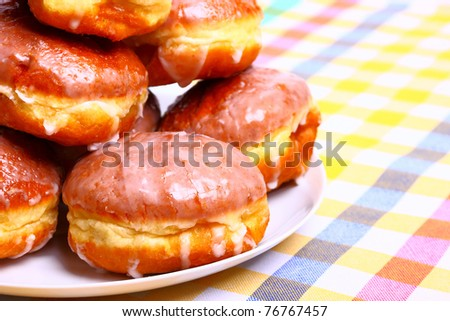 Delicious dessert made of several glazed donuts - stock photo