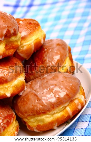 Delicious dessert made of several glazed donuts