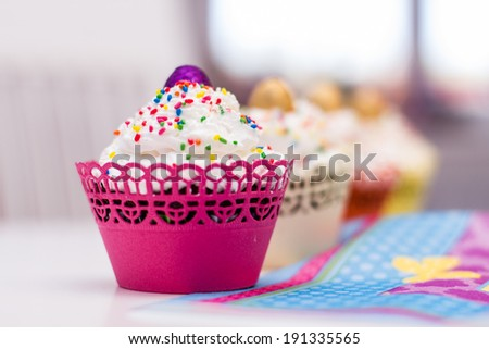 Delicious dessert muffins with decoration and cream.