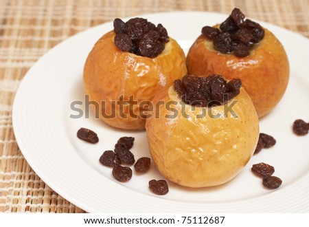 Delicious dessert of freshly baked organic apples with raisins