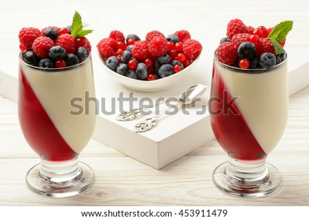 Delicious dessert - panna cotta with berry jelly and berries. - stock photo