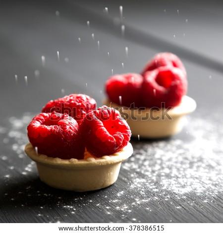 delicious dessert tarts with fresh raspberries - stock photo