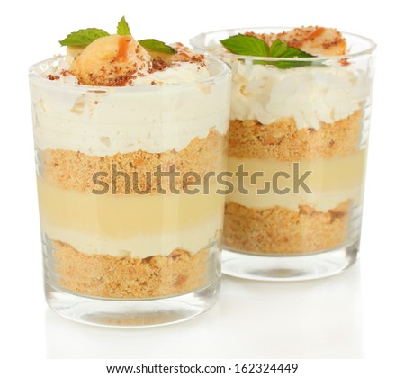Delicious dessert with banana and caramel isolated on white - stock photo