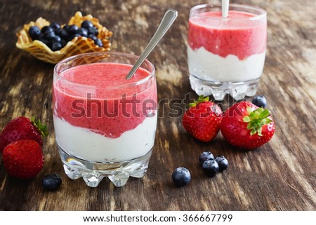 delicious dessert with cream and strawberry mousse in glass portioned. selective focus. health and diet food - stock photo