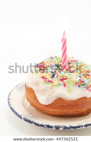 "Delicious Donut  ""Happy Birthday""  with a Candle."