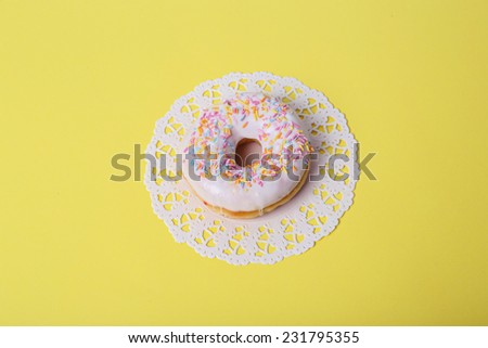 Delicious donut on the table - stock photo