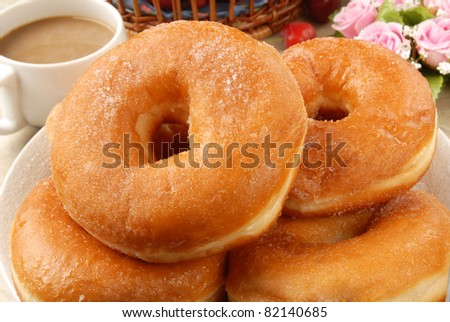 Delicious  donuts in the plate - stock photo