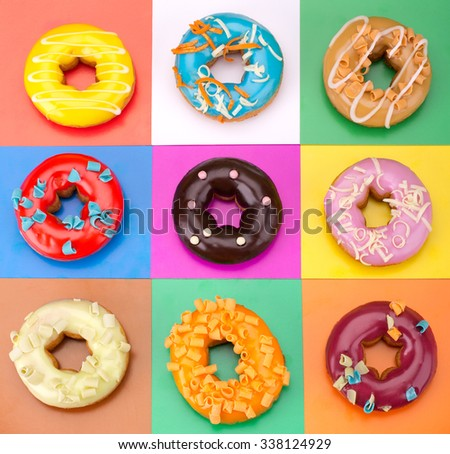 Delicious Donuts isolated on colorful background - stock photo