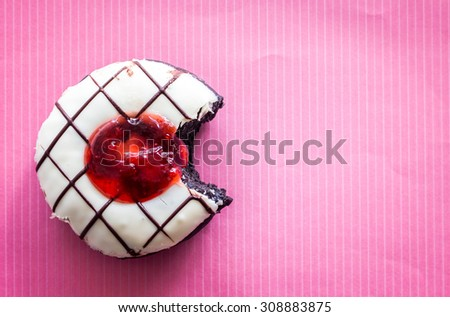 Delicious donuts on a pink background - stock photo