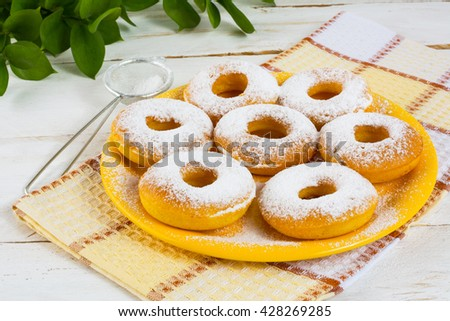 Delicious donuts on yellow plate. Sweet dessert. Sweet pastry. Doughnuts.  Donuts. Hanukkah donuts - stock photo