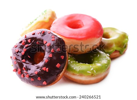 Delicious donuts with glaze isolated on white - stock photo