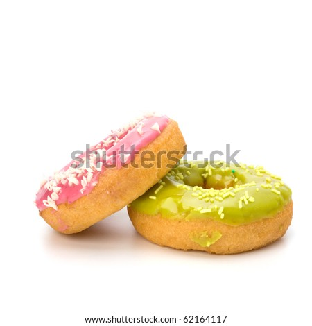 Delicious doughnuts isolated on white background - stock photo