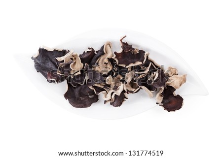 Delicious dried jew's ear mushrooms on white tray isolated on white background, top view with clipping path. Culinary asian cooking ingredient. - stock photo
