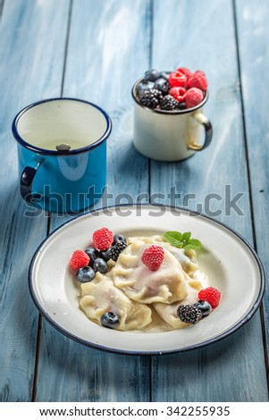 Delicious dumplings with fruits and cream