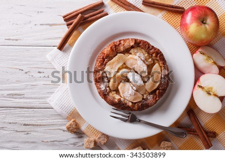 delicious Dutch baby pancake with apple closeup on a plate on the table.  Horizontal top view