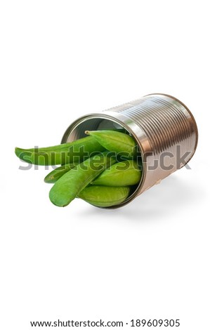 Delicious early spring peas in a small tin can. - stock photo