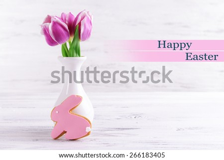 Delicious Easter cookies on table on light background - stock photo
