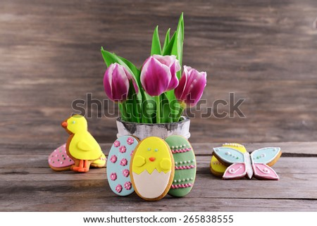 Delicious Easter cookies on table on wooden background - stock photo