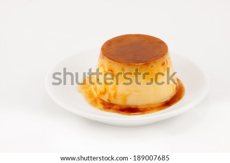 Delicious egg baked caramel flan liquid isolated on white background  - stock photo
