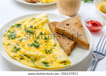 Delicious Egg Omelette with Greens and Cheese - stock photo