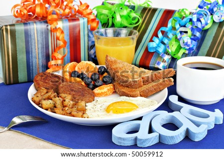Delicious egg, toast, sausage, home fries, fruit and coffee breakfast for dad's special day including gifts. - stock photo