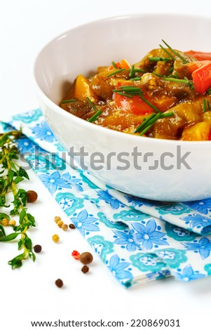 Delicious eggplant paste with tomato, sweet pepper and fresh herbs. Asian food. - stock photo