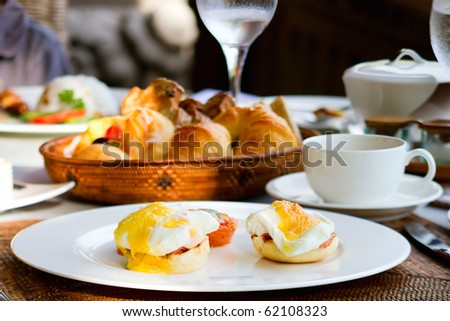 Delicious eggs Benedict served outdoors for breakfast - stock photo