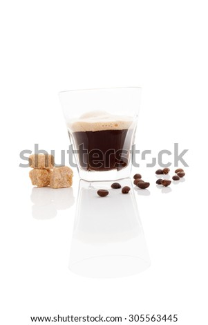 Delicious espresso with coffee beans and brown crane sugar isolated on white background. Traditional coffee drinking.  - stock photo