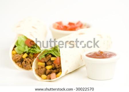 delicious fajitas beef lettuce tomato pepper corn isolated - stock photo