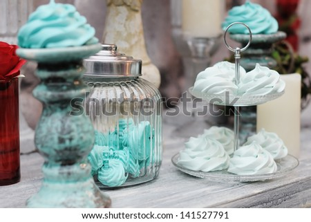 Delicious fancy mint pastila (red and blue wedding table set) - stock photo