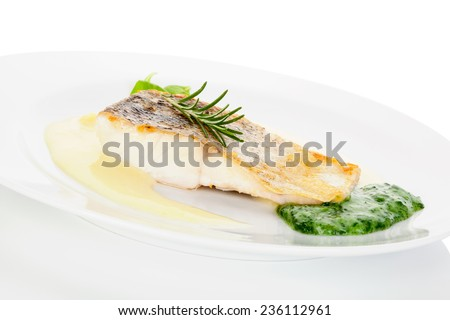 Delicious fish eating. Fresh perch fish fillet with potato and vegetable sauce on white plate isolated on white. Exquisite eating, fine gastronomy. - stock photo