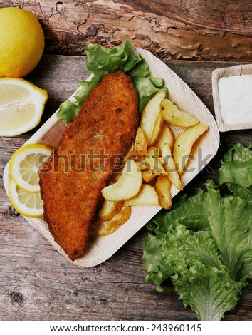 Delicious fish fillet with potato on the table