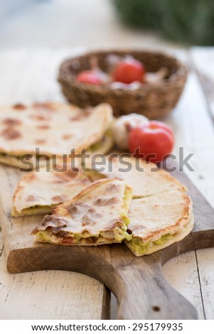Delicious flat-breads with vegetable and avocado filling  - stock photo