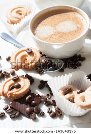 delicious flavored brewed coffee with biscuits and chocolate