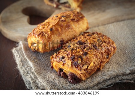 Delicious french chocolate bread pastries with toasted almond chips