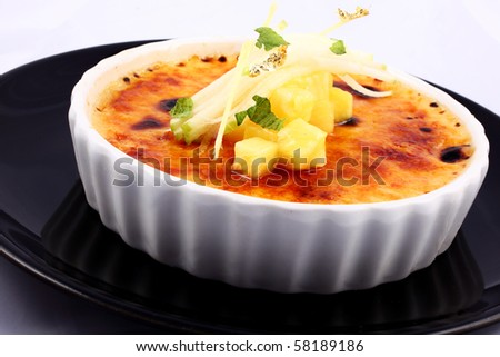 Delicious french dessert creme brulee in porcelain bowl - stock photo
