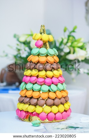 Delicious French macaroons on wedding reception - stock photo