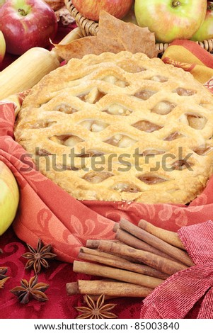 Delicious fresh baked apple pie with ingredients. Perfect for the holidays. - stock photo