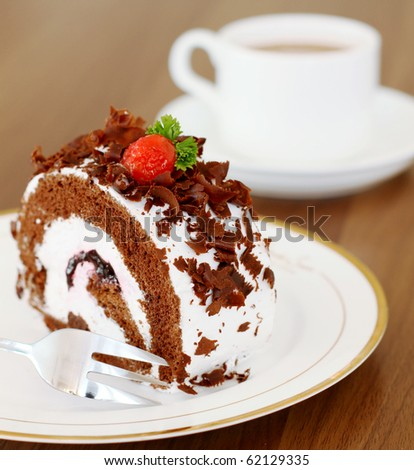 Delicious fresh baked chocolate cake with a cup of coffee - stock photo